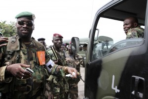 Issiaka Ouattara alias Wattao (L), a commander of FRCI (Republican Forces of Ivory Coast), stands with his soldiers in Yopougon April 29, 2011. REUTERS/Luc Gnago (IVORY COAST - Tags: POLITICS MILITARY)